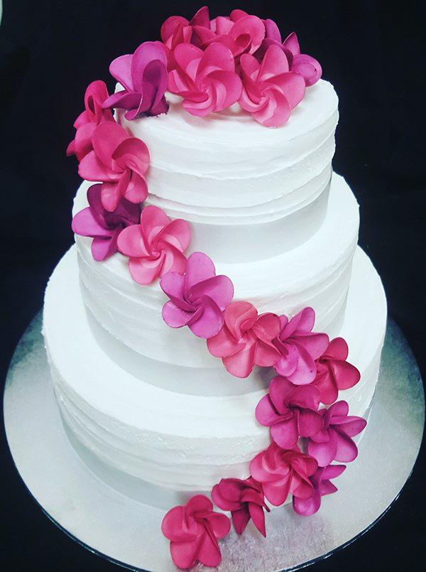 White Cake With Pink Frangipanis